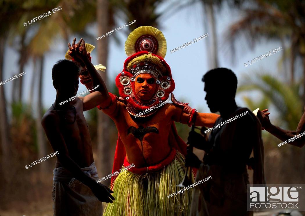 India, Kerala state, Thalassery, Theyyam artist performing