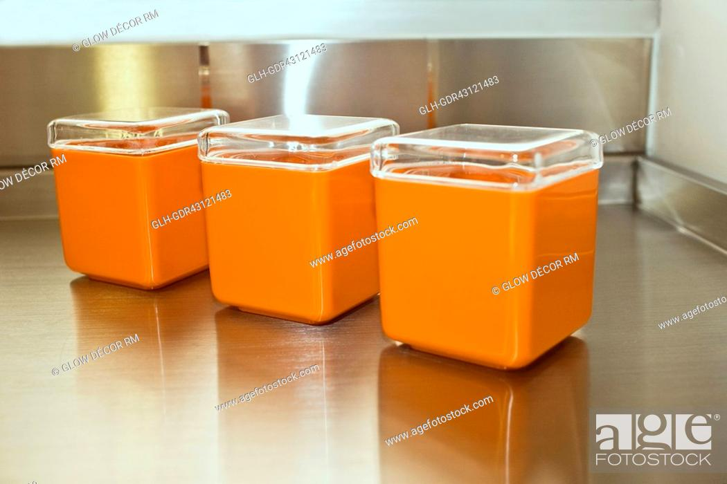Photo de stock: Three containers on a table.