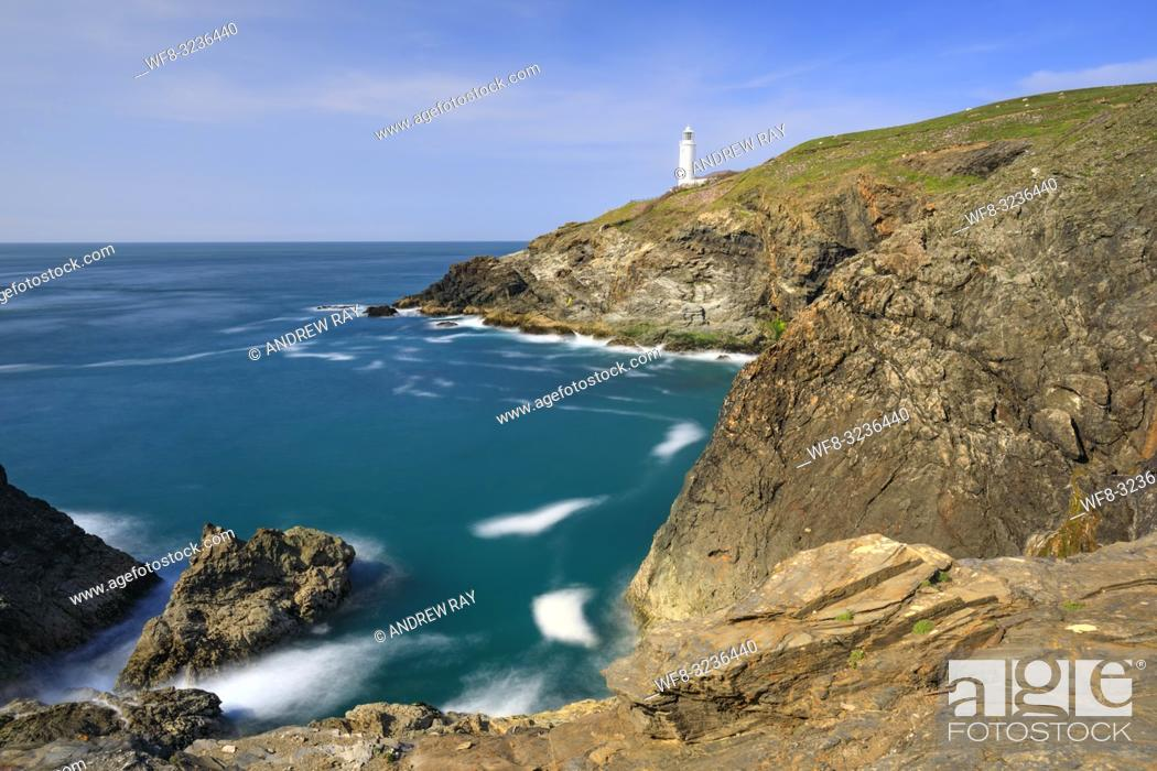 Stock Photo: The lighthouse on Trevose Head on the North Coast of Cornwall captured on an evening in mid May. A long shutter speed was utilized to blur the movement in the.