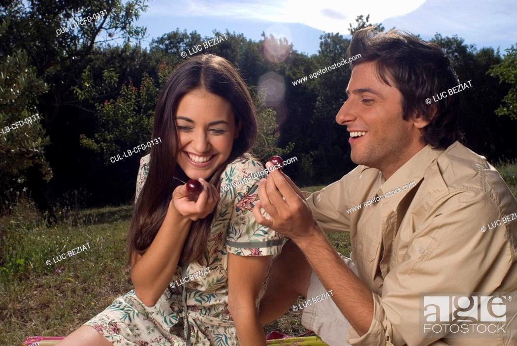 Stock Photo: Young couple sharing fresh fruit.