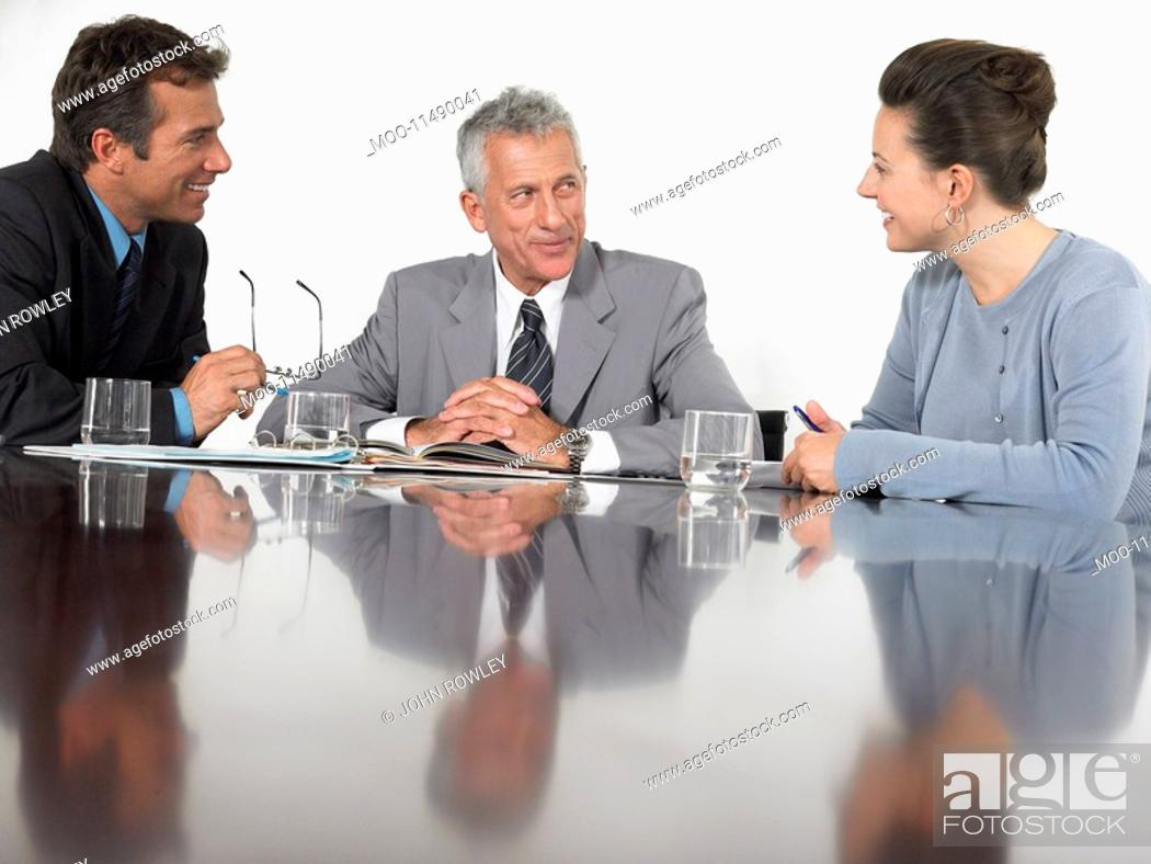Stock Photo: Three business colleagues in conference meeting.