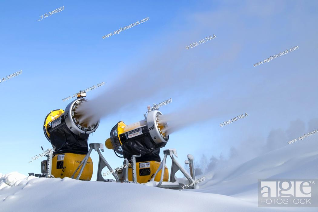 Stock Photo: snow cannons spraying artificial snow.