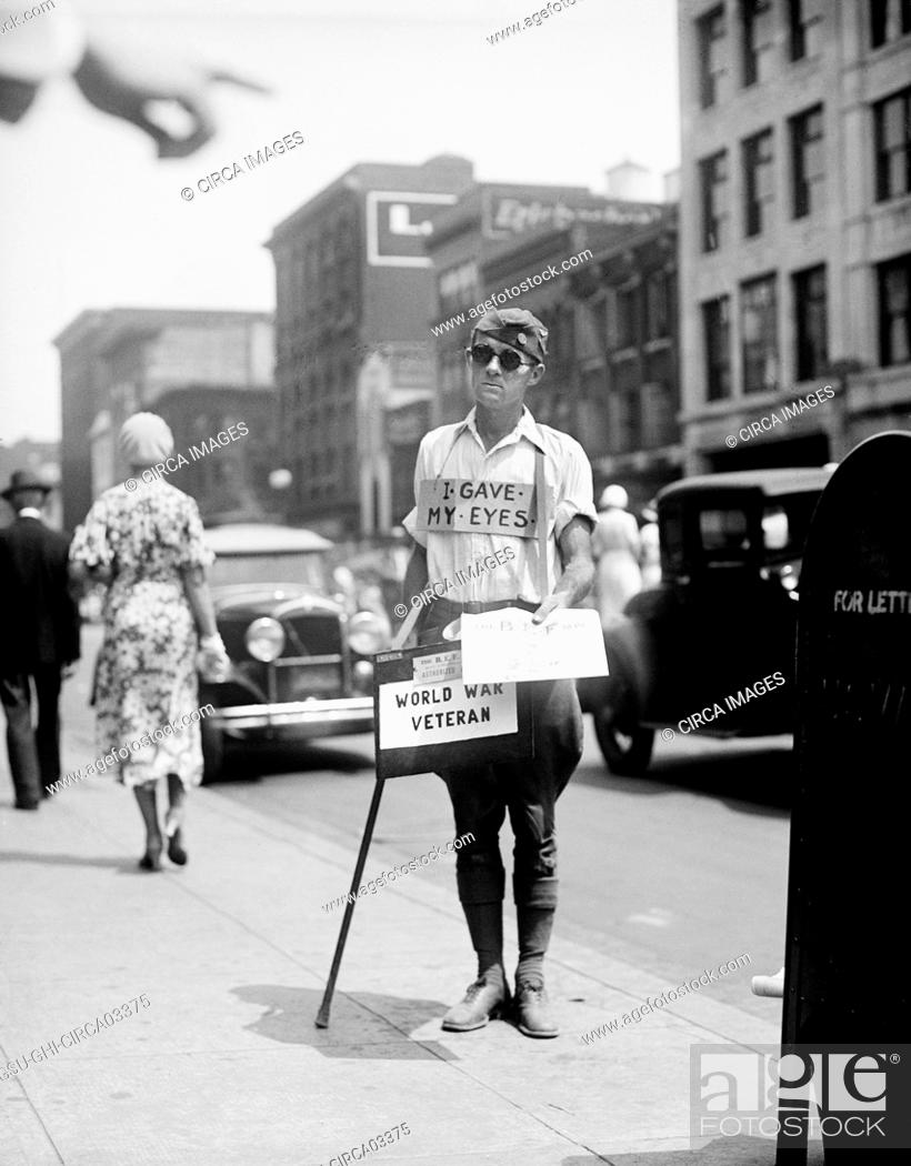 Stock Photo: Blind World War I Veteran Selling Newspapers on Sidewalk, Washington DC, USA, 1933.