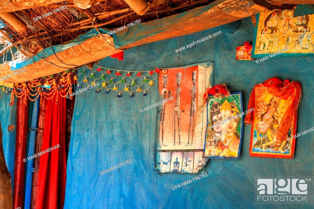 Tribal hut with picture of gods, bastar, chhattisgarh, india