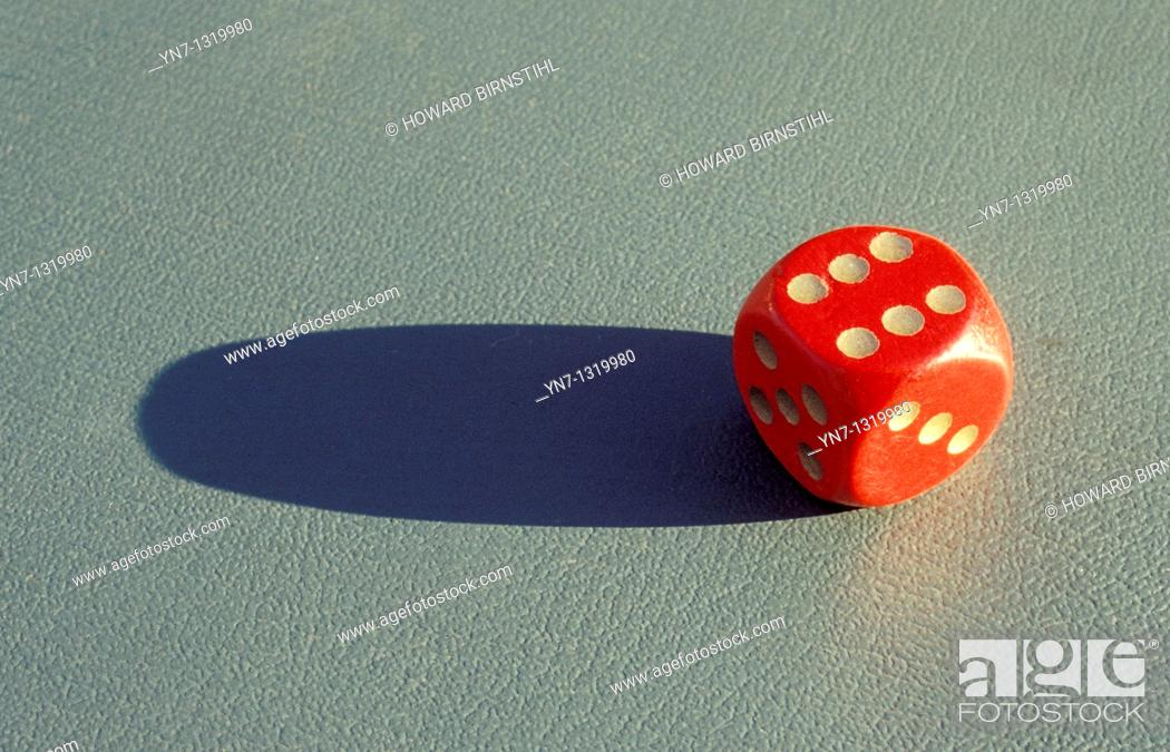 Stock Photo: close up of red dice landed on six.