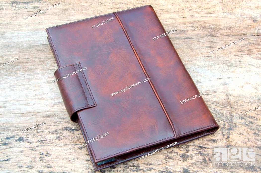Stock Photo: Brown leather organizer planner on the wooden backgrounde. Front and back side.