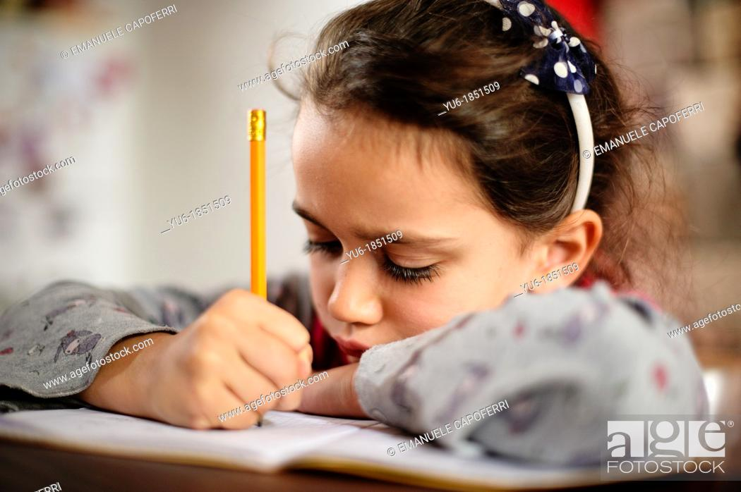 Stock Photo: Child exercise the tasks of school.