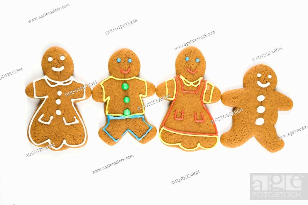 Stock Photo: Gingerbread cookies holding hands.