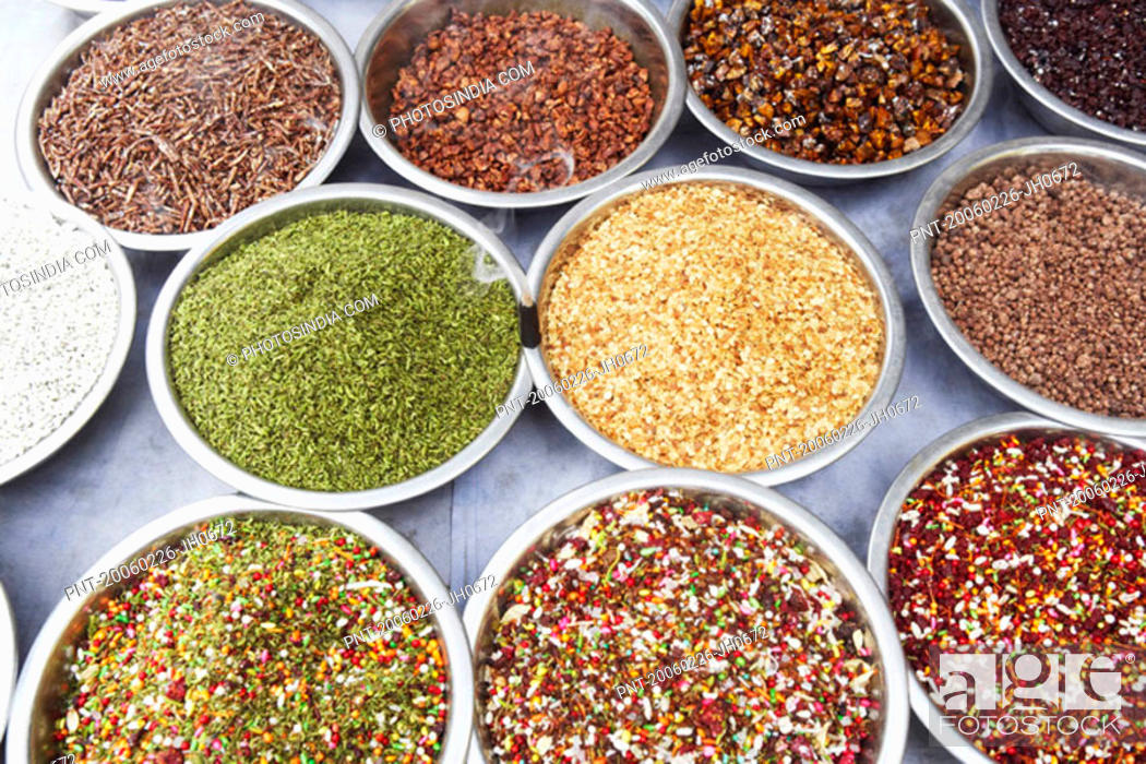 Stock Photo: High angle view of assorted spices at a spice stall.