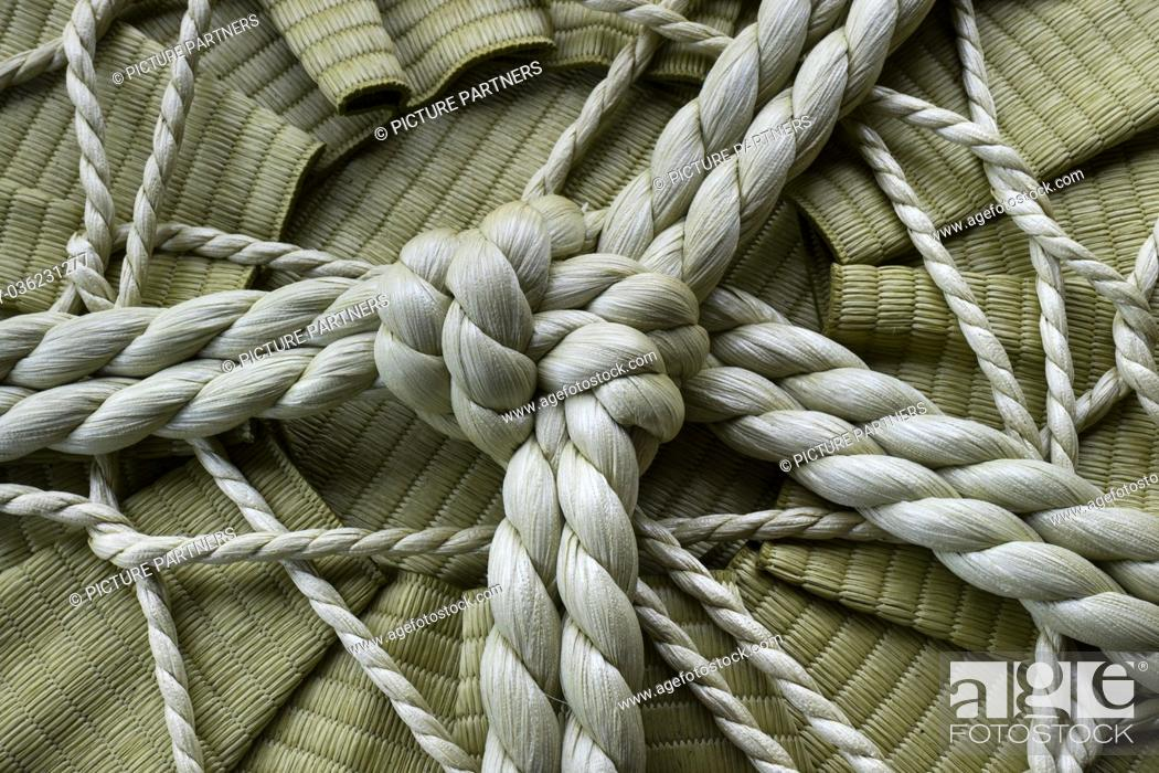 Stock Photo: Knotted rope on a sake barrel close up in Jpan.