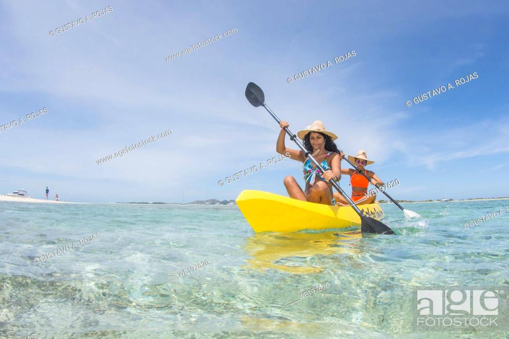 Stock Photo: Beautiful Women Paddling on Kayak in Caribbean Sea. Travel and Beach Vacation.