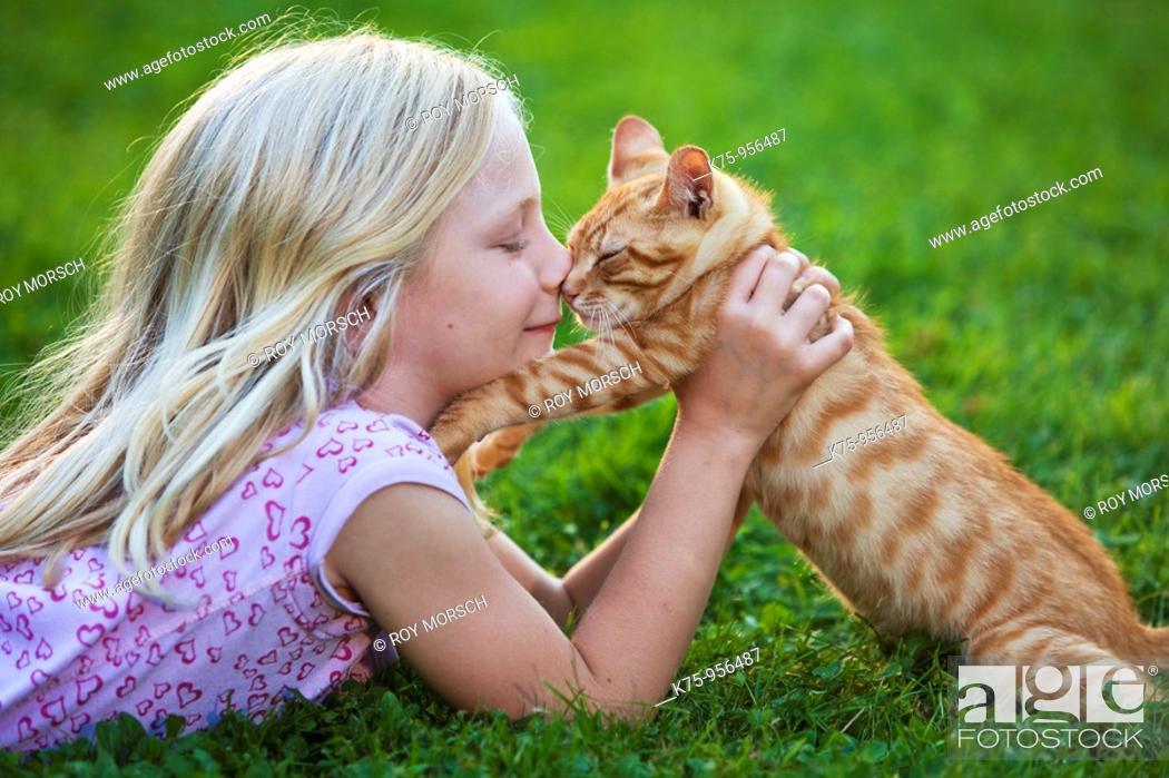 Stock Photo: girl with kitten.