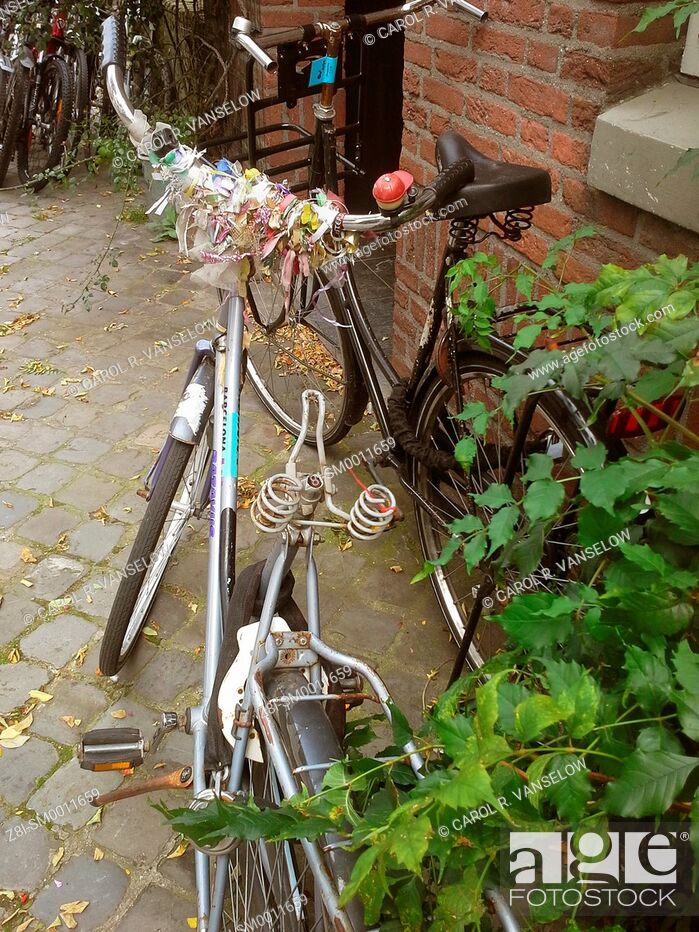 Stock Photo: Bicycle with many coloured ribbons on handlebars, but no seat. Photo is taken in Maastricht, the Netherlands.