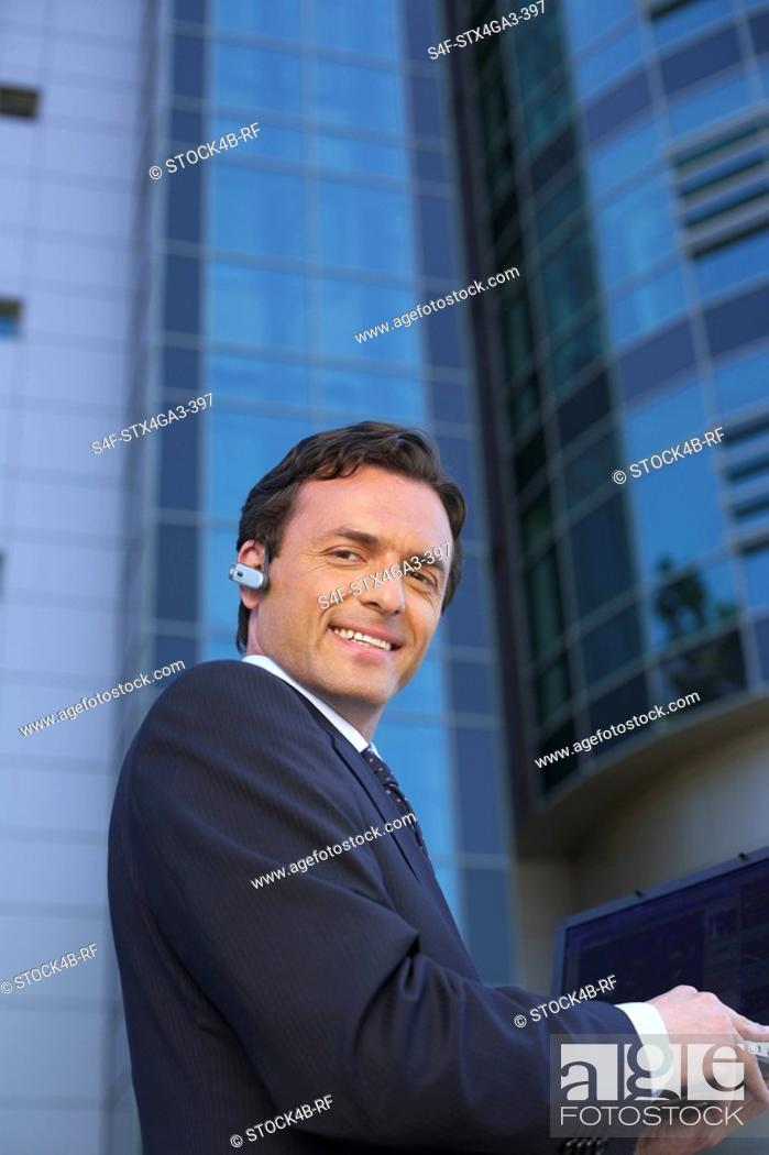 Stock Photo: Businessman with laptop.