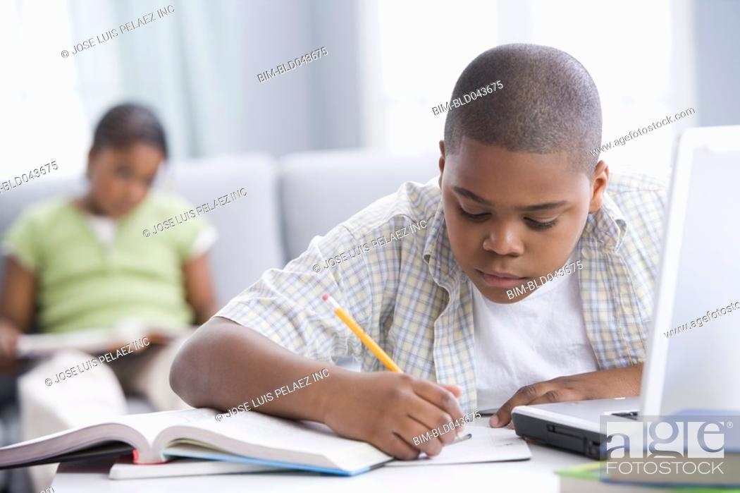 Stock Photo: African American boy doing homework.
