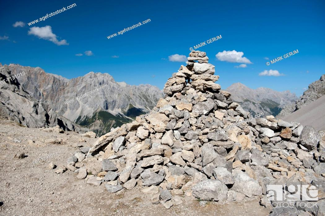 Stock Photo: A large pile of rocks forming a cairn in the Wetterstein Mountains, Austria.