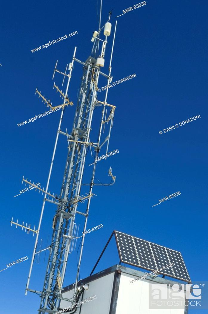 solar panels and repeater with antennas, pora mountain, italy, Stock