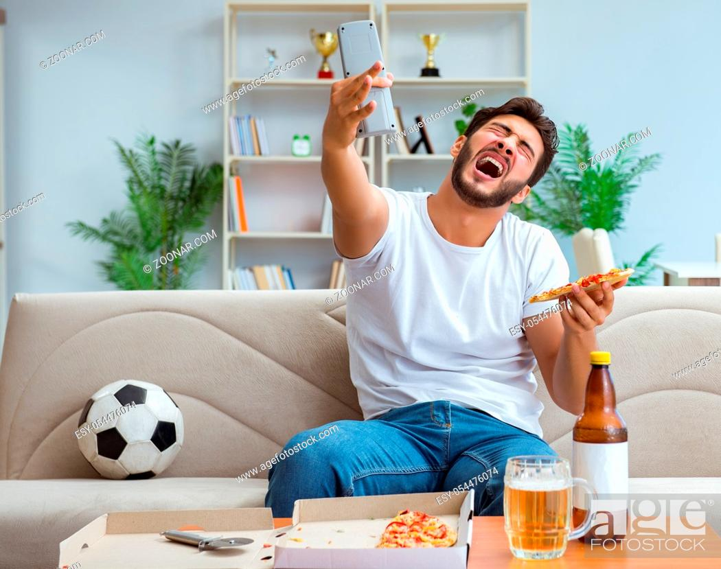 Stock Photo: The man eating pizza having a takeaway at home relaxing resting.