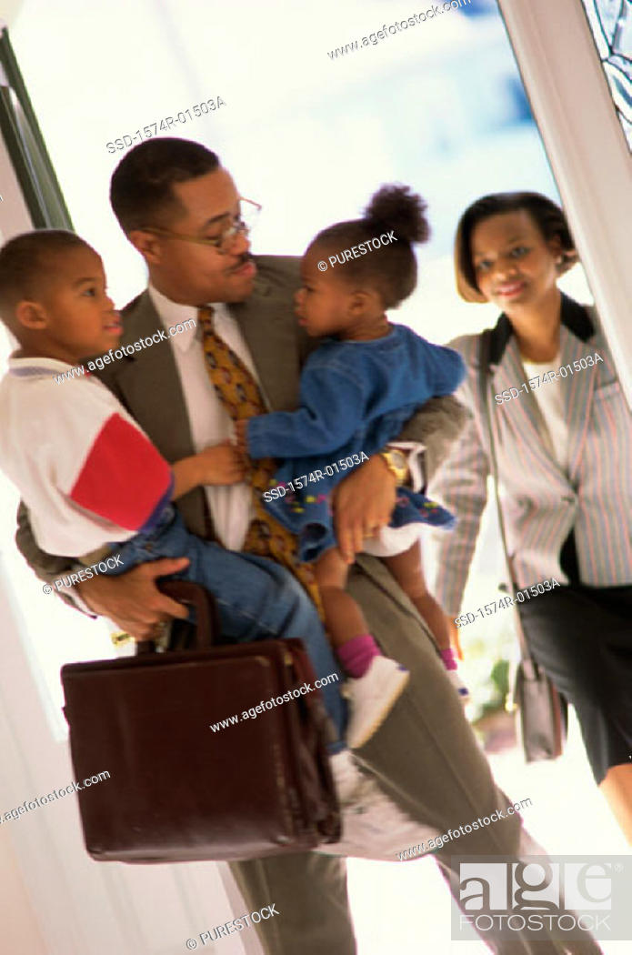 Stock Photo: Father holding his children.