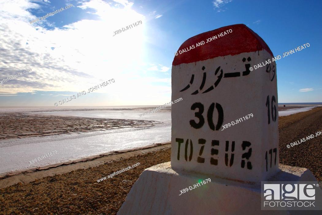 Stock Photo: Africa, Tunisia, Chott El Jerid, Flat Dry Salt Lake, Highway between Tozeur and Kebili, Distance Signpost.