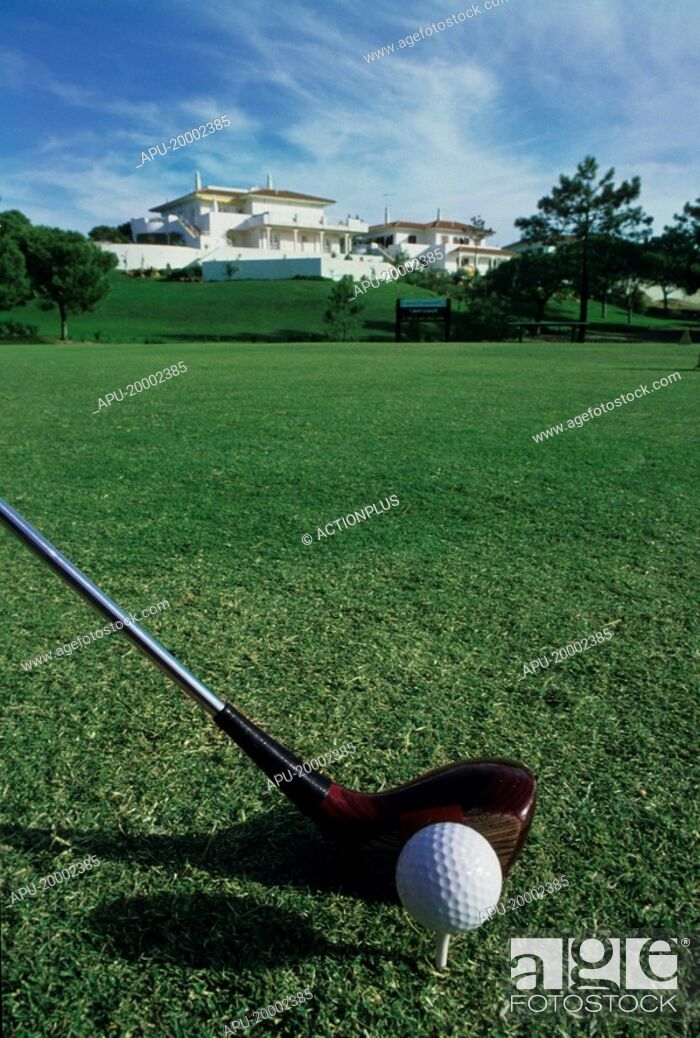 Stock Photo: View of golfer about to strike ball with a wooden club.