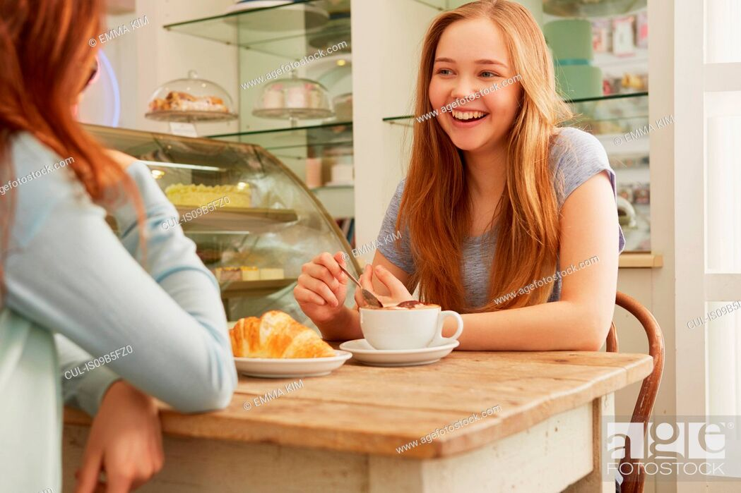Stock Photo: Friends in cafe smiling.