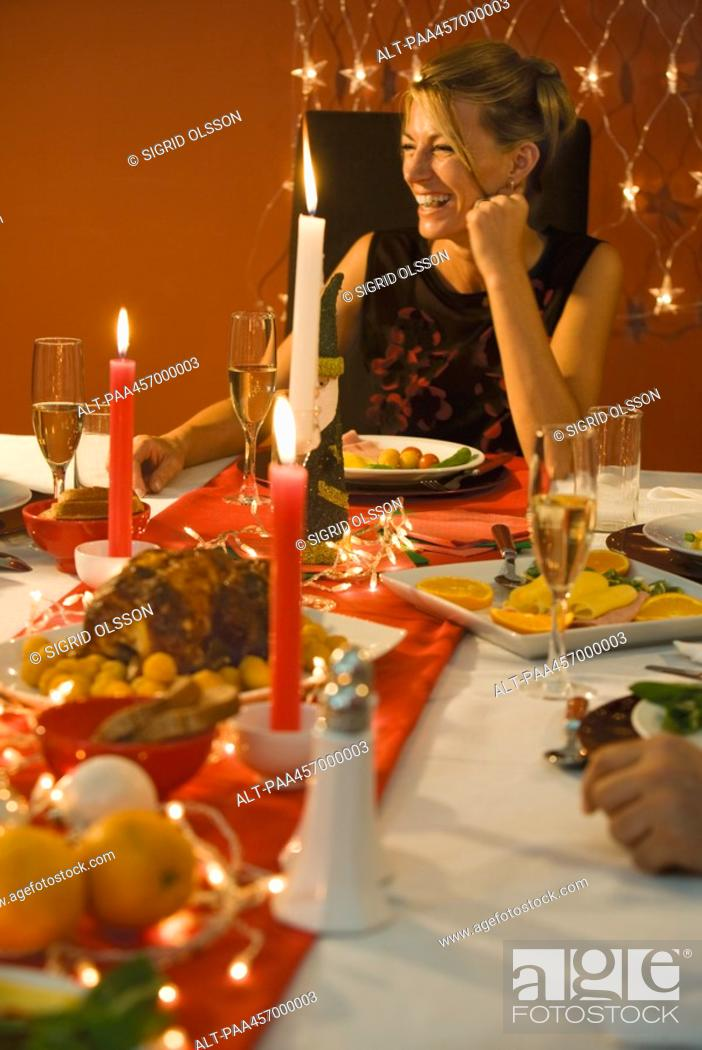 Stock Photo: Woman eating Christmas dinner, laughing.