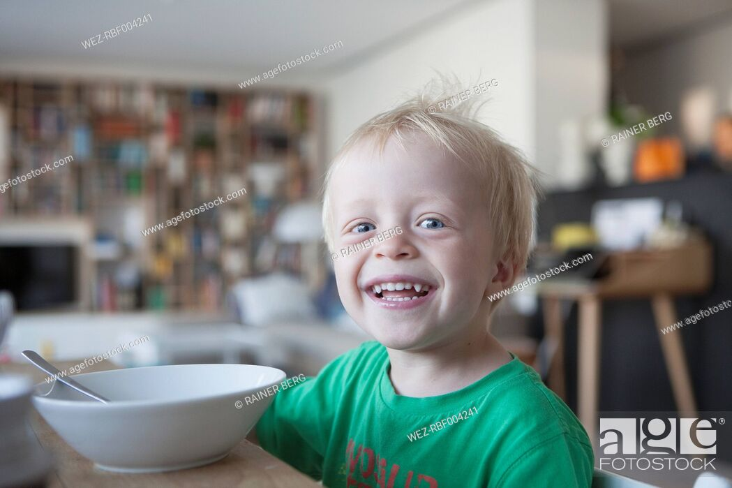 Stock Photo: Portrait of happy little blond boy at home.