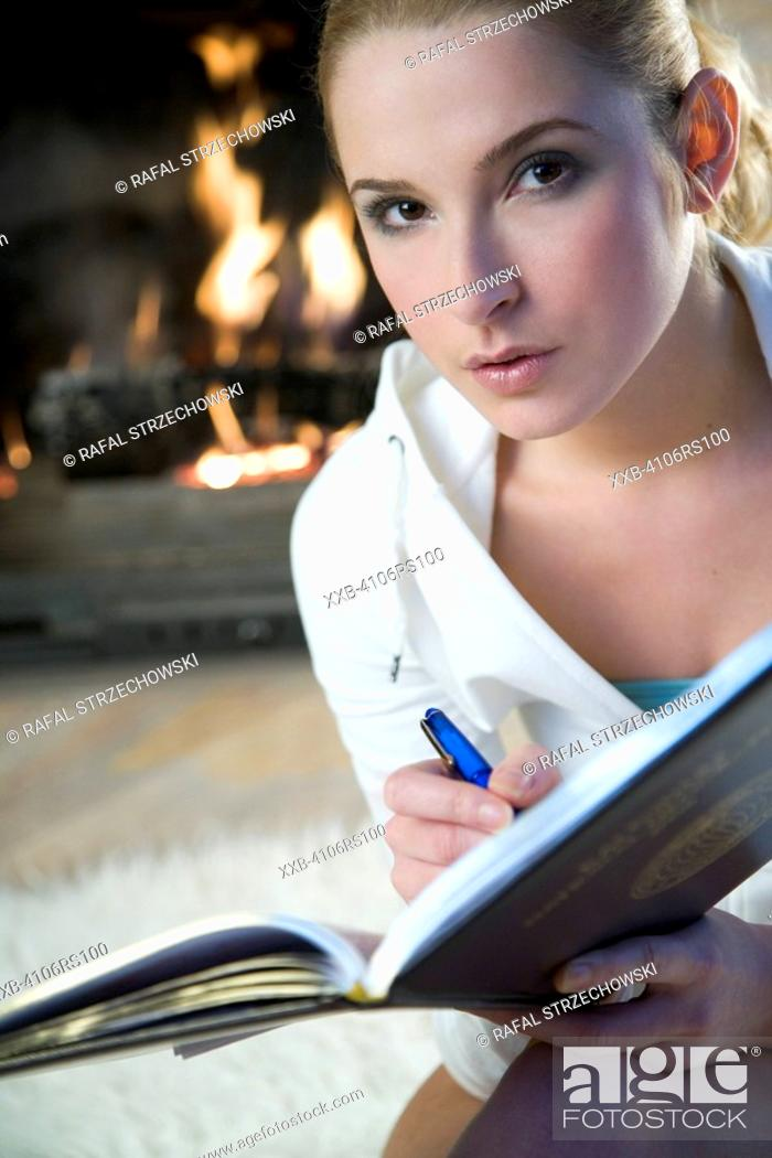 Stock Photo: young woman studing.
