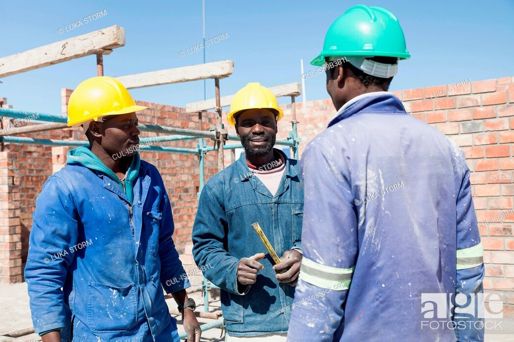 Stock Photo: Builders talking on construction site.