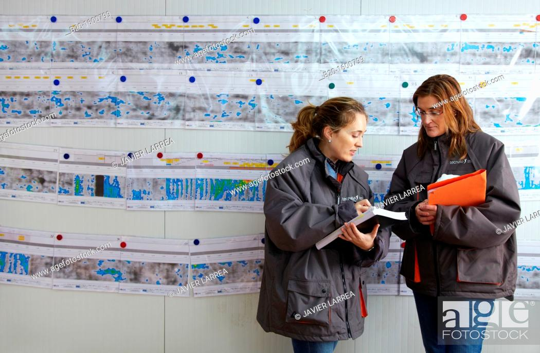 Stock Photo: Architects supervising the planes of the skin and the sections of a tunnel, Works of the new railway platform in the Basque Country.
