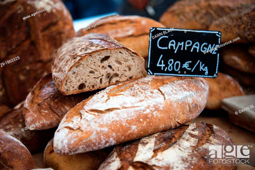 Stock Photo: Fresh Campagne bread on market stall.