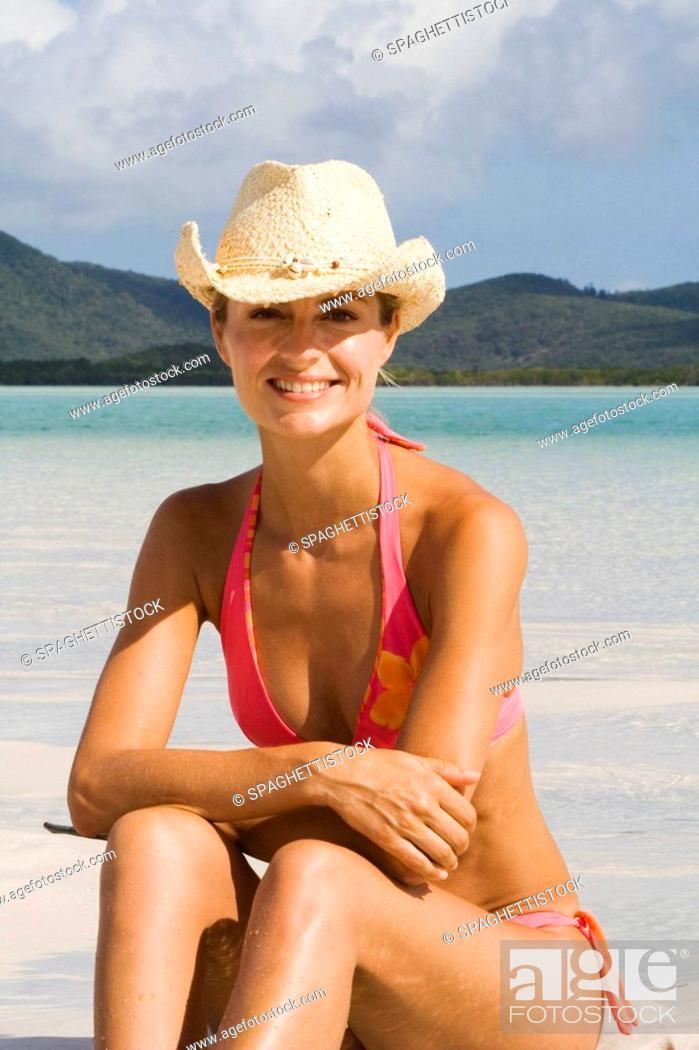Stock Photo: Portrait of woman in bikini and cowboy hat. Whitehaven Beach, Australia.