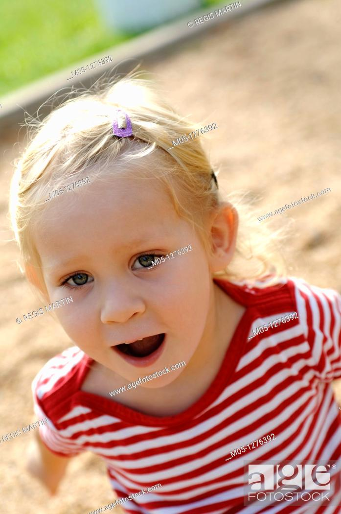Stock Photo: Three years old toddler playing at the playground.