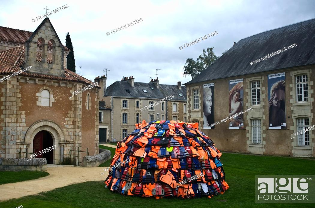 """Stock Photo: Piece of art by Achilleas Souras between two monuments : the """"""""baptistère Saint Jean"""""""" and the Sainte Croix museum ( Poitiers, France)."""