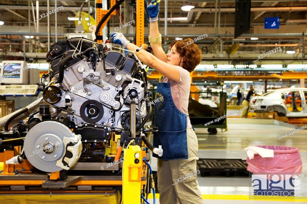 Stock Photo: Sterling Heights, Michigan - Members of the United Auto Workers union assemble the 2007 Chrysler Sebring sedan at DaimlerChrysler's Sterling Heights Assembly.