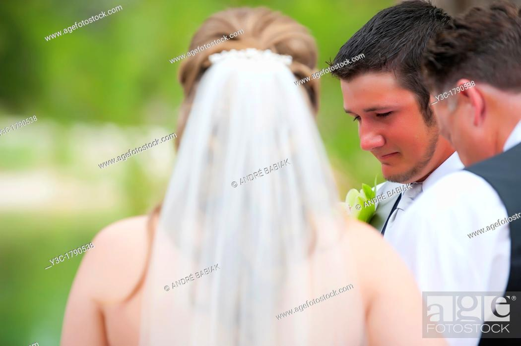 Stock Photo: Bride and groom praying at their outdoor wedding.