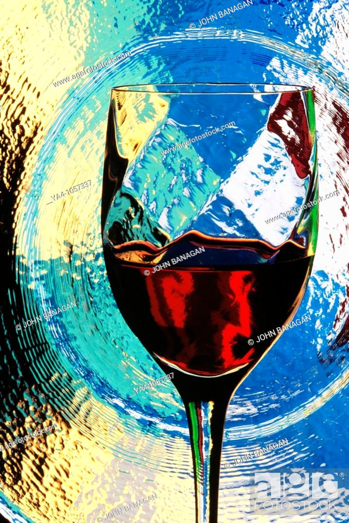 Stock Photo: Glass of re wine with glass behind and coloured gels.