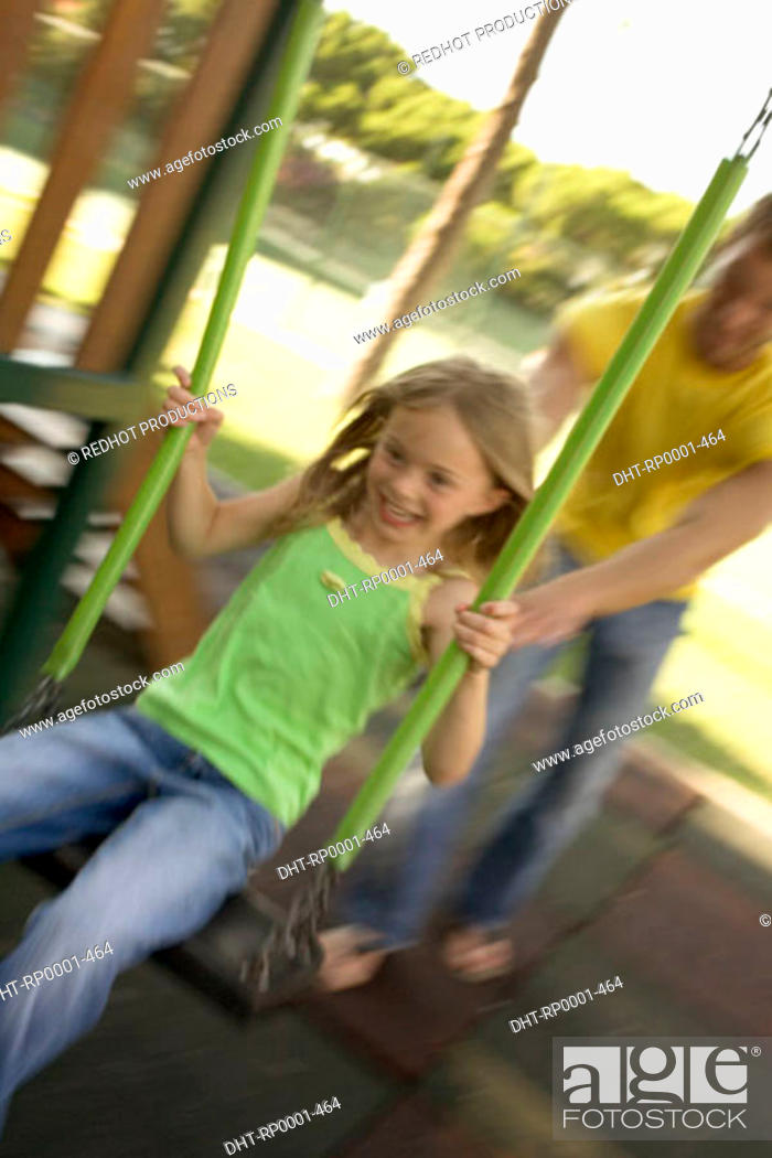 Stock Photo: Father and Daughter in Park on swing.