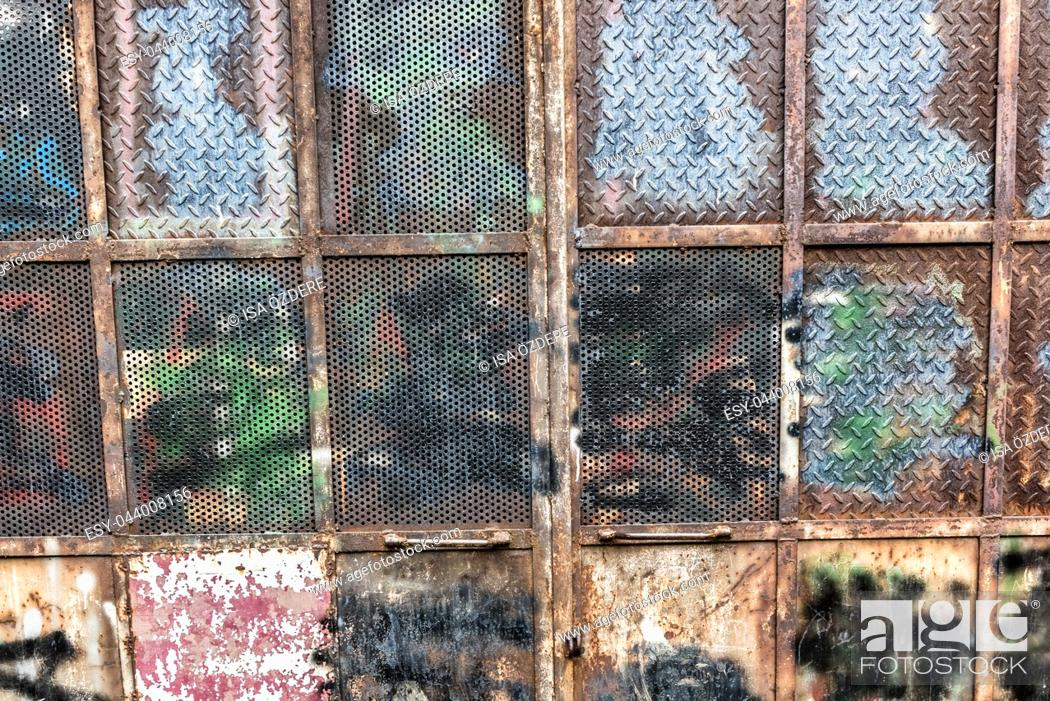 Stock Photo: Metal door plate texture and background. The metal surface rusted spots. Rusty metal grunge background. Metal background.
