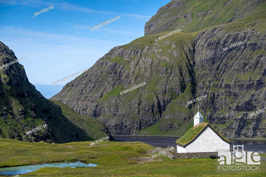 Stock Photo: Small church with grass roof in mountain landscape, Saksun, Streymoy, Faroe Islands, Føroyar, Denmark, Europe.