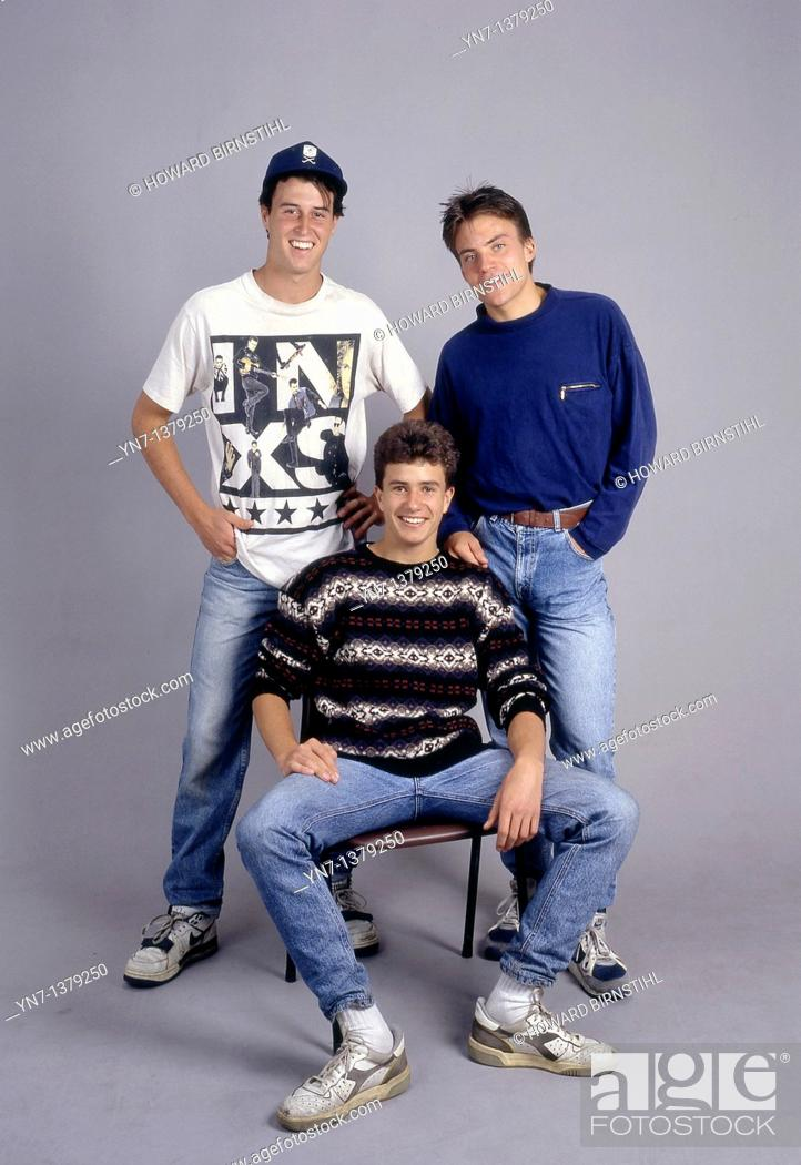 Stock Photo: studio portrait full length of three happy teenage boys.