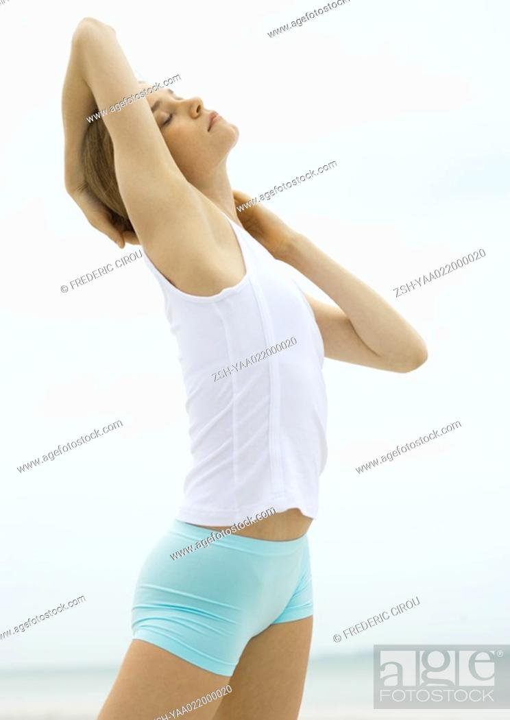 Stock Photo: Young woman stretching.