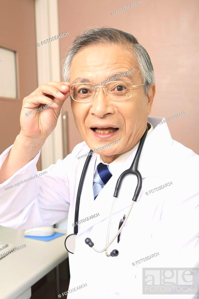 Stock Photo: Doctor wearing glasses.