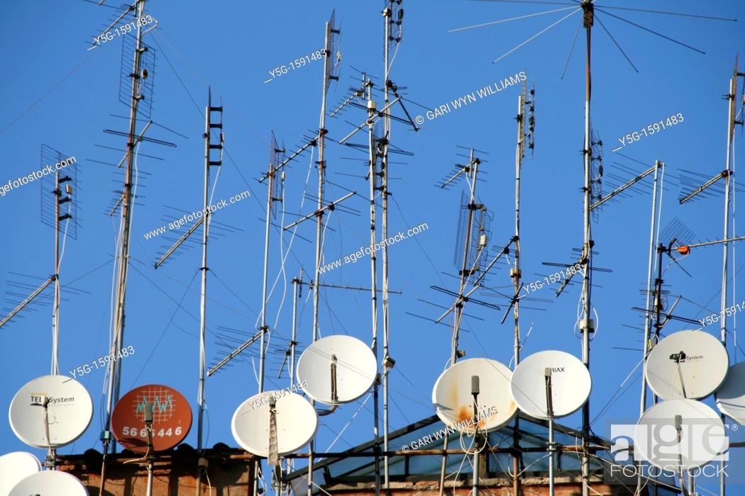 Stock Photo: tv aerials and satellite dishes on rooftop.