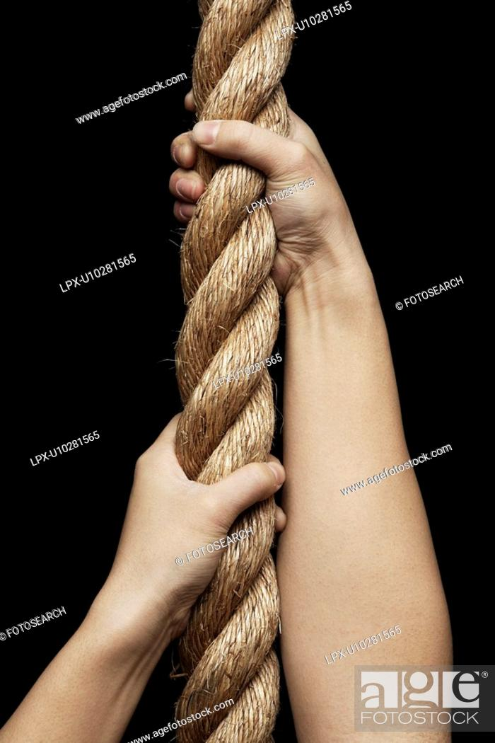 Stock Photo: Person Pulling Rope.