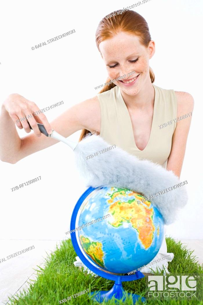Stock Photo: woman cleaning globe.