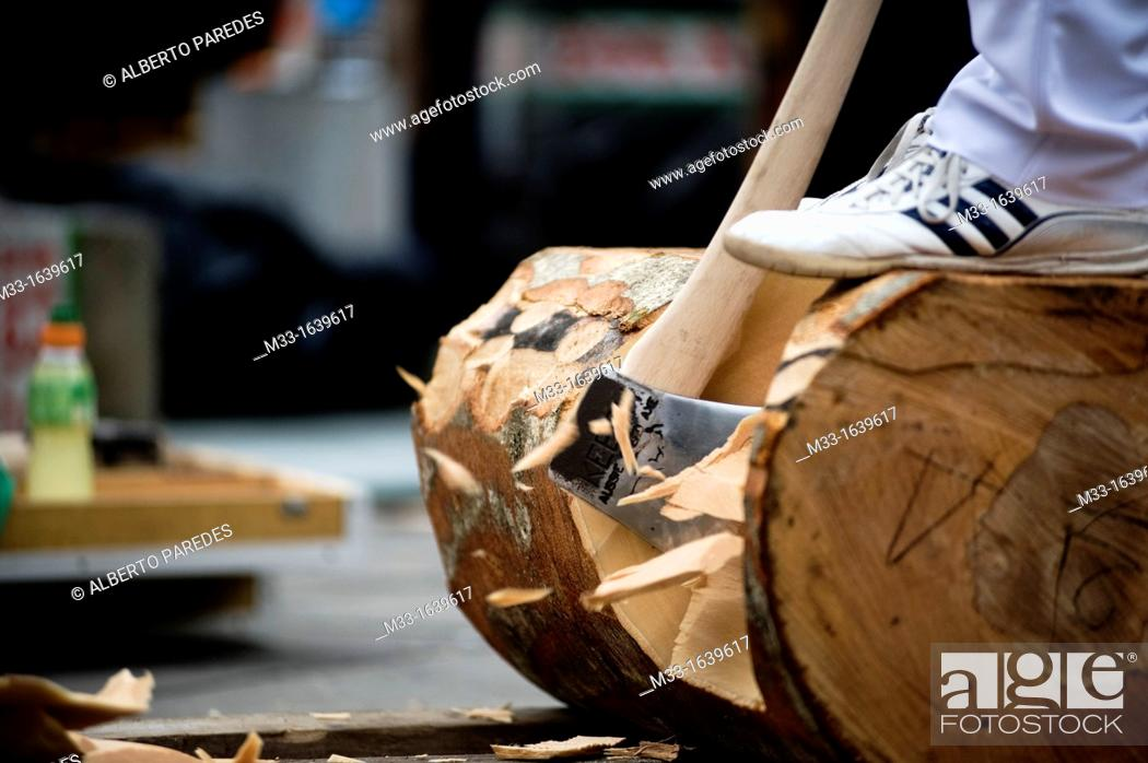 Stock Photo: Wood cutters or aizkolaris in Basque language  Exhibition in Azkoitia  Basque rural sports Herri Kirolak in basque language are rooted in traditional lifestyles.