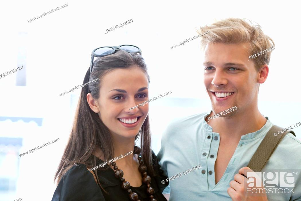Stock Photo: Smiling young couple standing together.