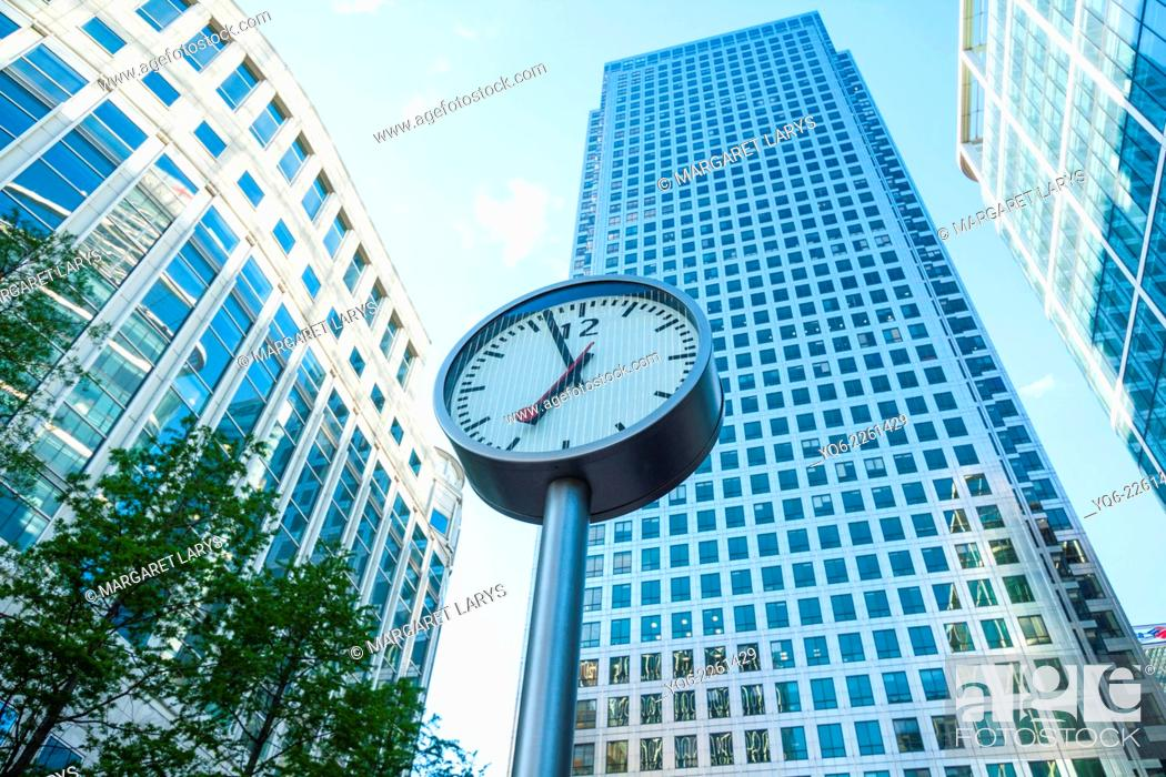 Stock Photo: Modern architecture, Clock, Canary Warf, Docklands, London, England.